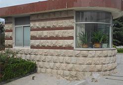 木兰红花岗岩作保安房外墙